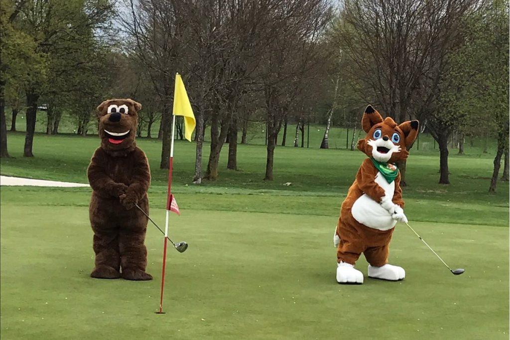 Maskottchen Petzen und Walderlebniswelt am Golfplatz
